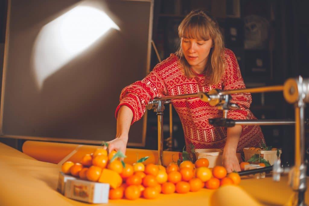 Director creates a unique set design from oranges and tangerines