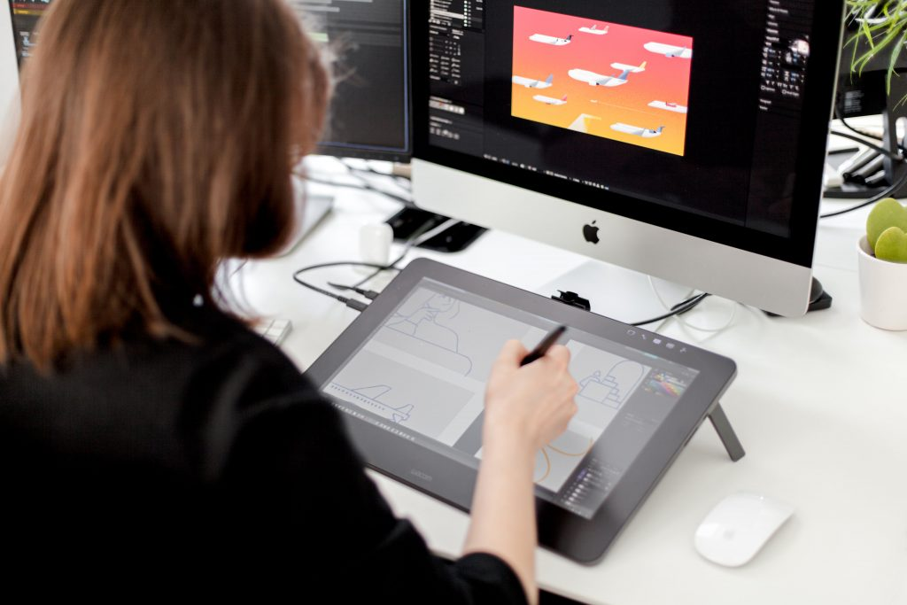 Graphic designer drawing animation storyboard on a tablet